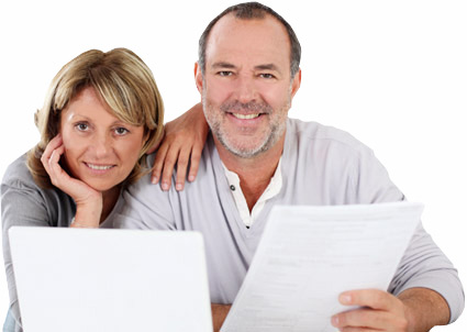 Couple at computer with documents